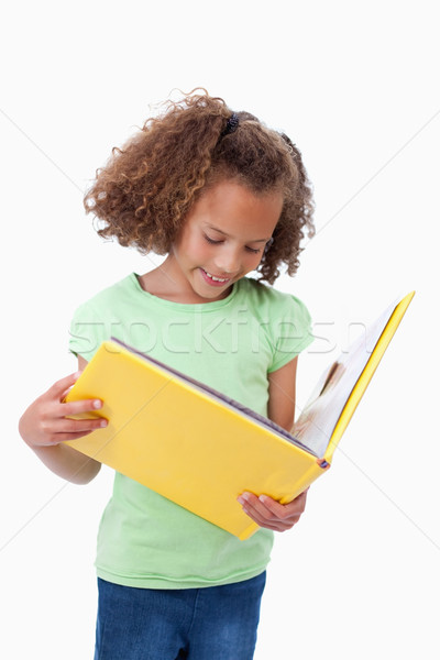 Portrait of a girl reading a fairy tale against a white background Stock photo © wavebreak_media