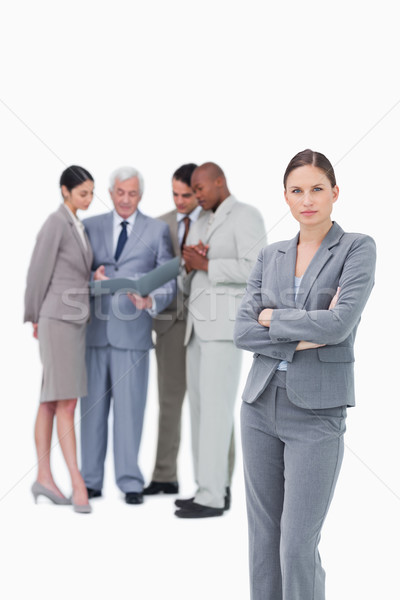 Tradeswoman with folded arms and colleagues behind her against a white background Stock photo © wavebreak_media