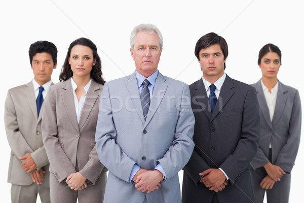 Mature businessman standing together with his team against a white background Stock photo © wavebreak_media