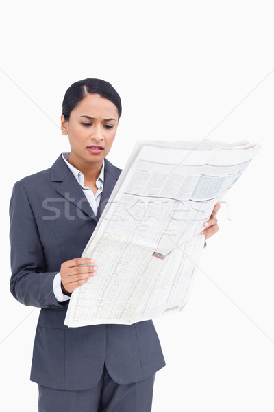 Close up of saleswoman reading the news against a white background Stock photo © wavebreak_media