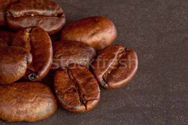 Many coffee seeds laid out together on a black table Stock photo © wavebreak_media