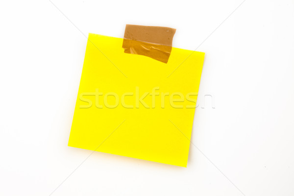 Sticky note with adhesive tape against a white background Stock photo © wavebreak_media