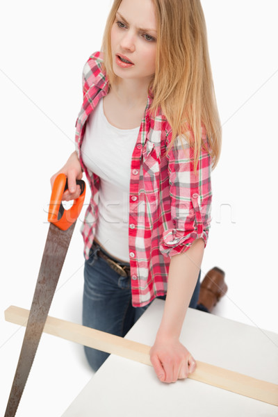 Woman using a wood saw Stock photo © wavebreak_media