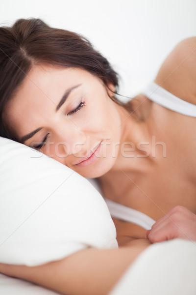 Békés nő ágy fényes hálószoba női Stock fotó © wavebreak_media
