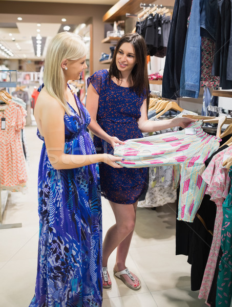Women  standing at a clothes rail and smiling at a shopping mall  Stock photo © wavebreak_media