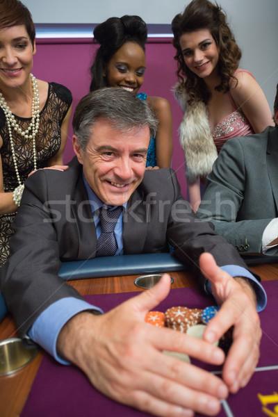 Man chips roulette tabel schoonheid casino Stockfoto © wavebreak_media