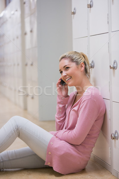 Woman sitting on the floor at the hallway phoning  Stock photo © wavebreak_media
