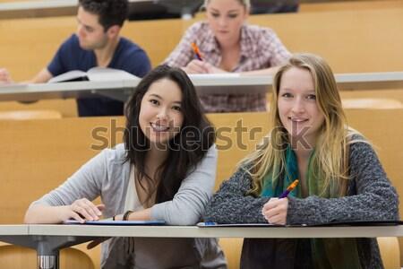 Studentów posiedzenia wykład sali uśmiechnięty Zdjęcia stock © wavebreak_media
