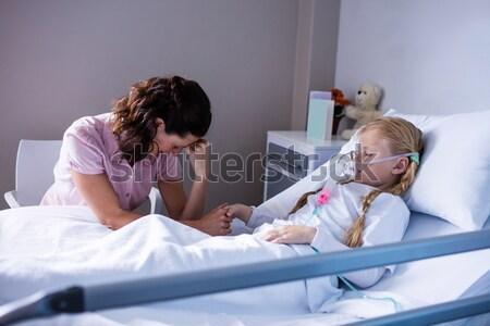 Thoughtful doctor sitting on a hallway Stock photo © wavebreak_media