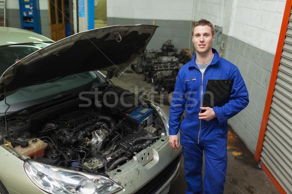 Mechanic standing by car with open hood Stock photo © wavebreak_media