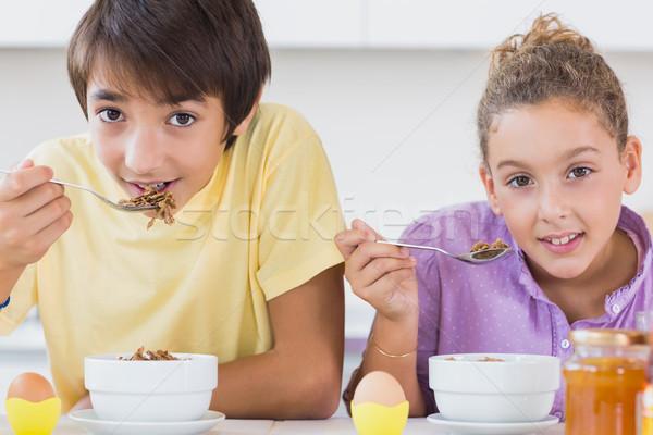 Happy siblings having breakfast Stock photo © wavebreak_media