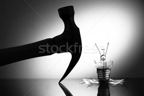 Clear light bulb broken by hammer Stock photo © wavebreak_media
