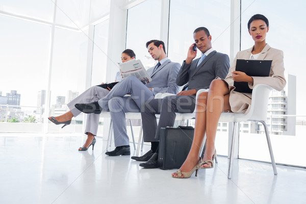 Uomini d'affari lavoro attesa ufficio suit lettura Foto d'archivio © wavebreak_media