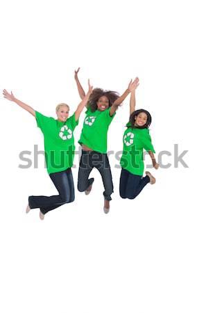 Atlama gülen üç beyaz kadın portre Stok fotoğraf © wavebreak_media