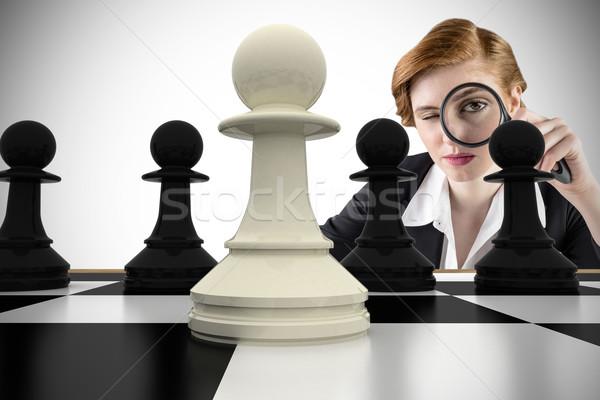 Composite image of focused businesswoman with magnifying glasses Stock photo © wavebreak_media