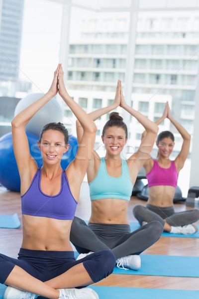 Smiling people in Namaste position at fitness studio Stock photo © wavebreak_media