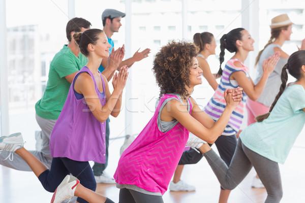 Fitness classe instructeur pilates exercice vue de côté Photo stock © wavebreak_media