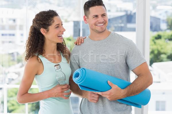 Couple holding water bottle and exercise mat Stock photo © wavebreak_media