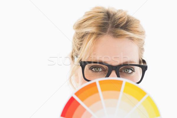 Blonde designer wearing glasses holding colour wheel Stock photo © wavebreak_media