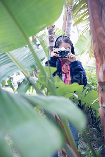 Attractive brunette taking a picture Stock photo © wavebreak_media