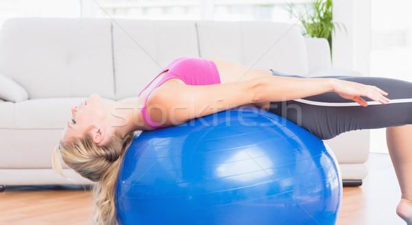 Slim blonde stretching her back on exercise ball Stock photo © wavebreak_media