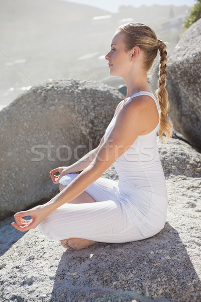 Szőke nő ül lótusz póz kő napos idő Stock fotó © wavebreak_media