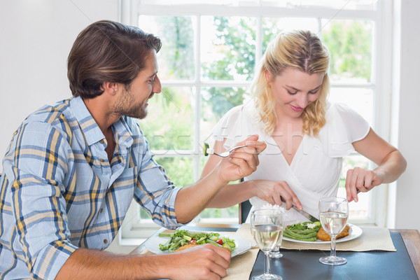 Cute smiling couple having a meal together Stock photo © wavebreak_media