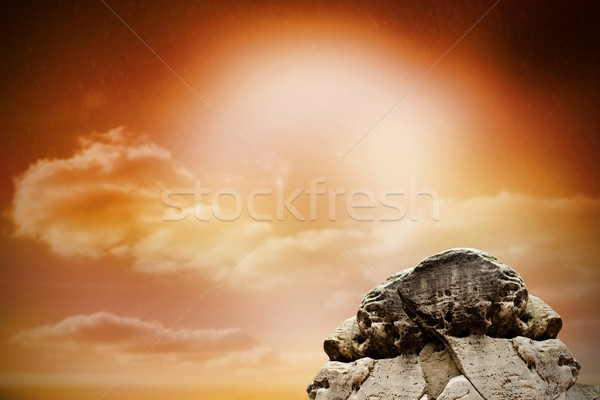 Large rock overlooking orange sky Stock photo © wavebreak_media