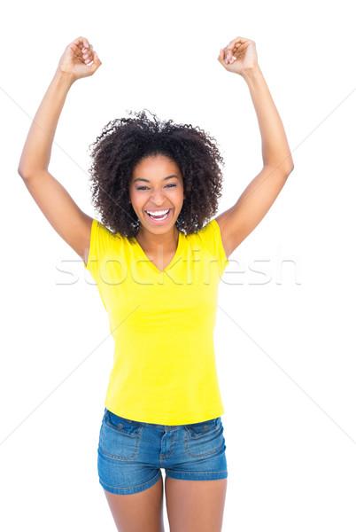 довольно девушки желтый футболки джинсовой горячей Сток-фото © wavebreak_media