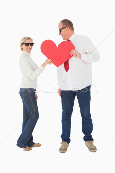 Older affectionate couple holding red heart shape Stock photo © wavebreak_media