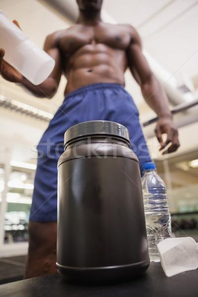 Body builder scooping up protein powder Stock photo © wavebreak_media