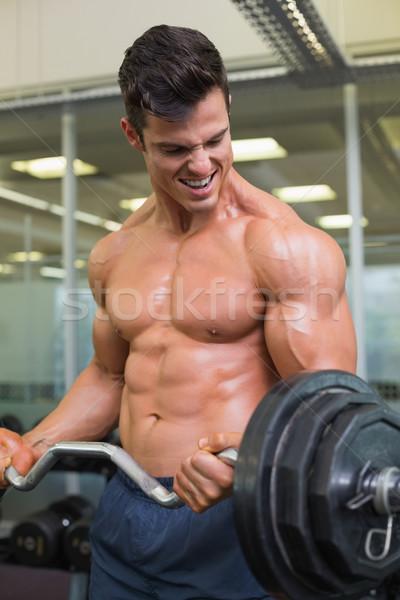 Półnagi muskularny człowiek sztanga siłowni Zdjęcia stock © wavebreak_media