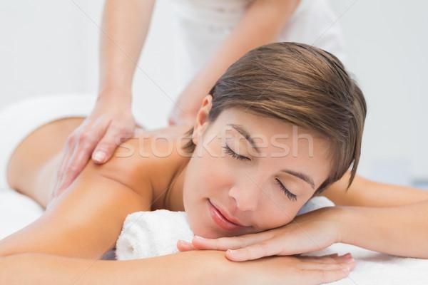 Attractive woman receiving back massage at spa center Stock photo © wavebreak_media