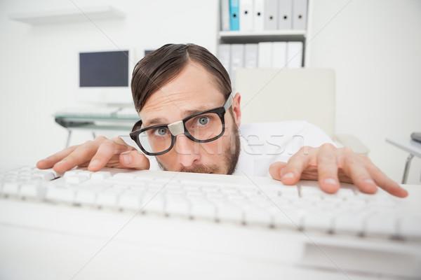 Nerdy businessman working on computer Stock photo © wavebreak_media
