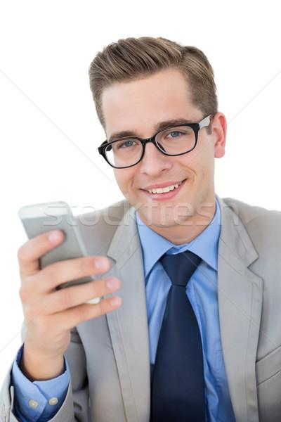 Stock photo: Nerdy businessman sending a text