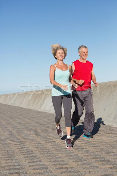 Active senior couple out for a jog Stock photo © wavebreak_media