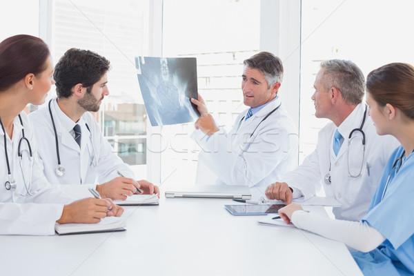 Doctor holding up an x-ray Stock photo © wavebreak_media