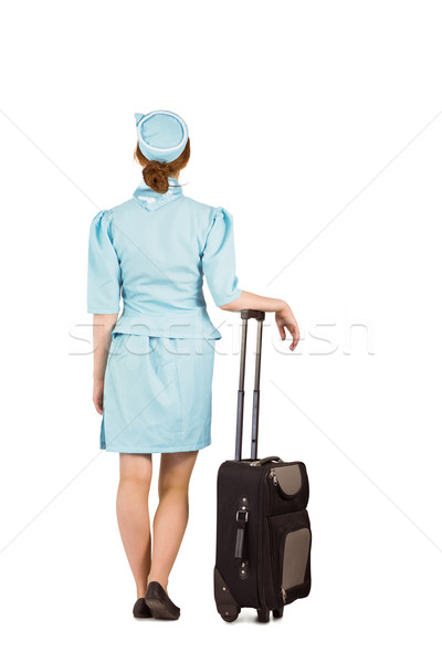 Pretty air hostess leaning on suitcase Stock photo © wavebreak_media