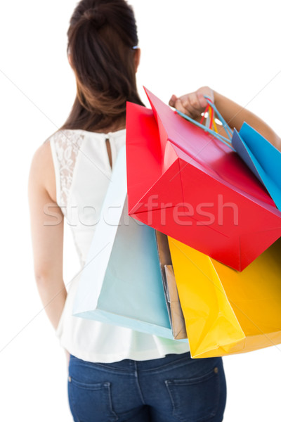 Rear view of brown hair holding shopping bags Stock photo © wavebreak_media