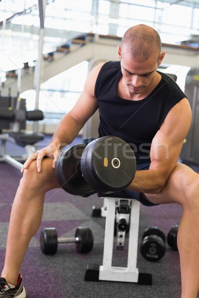 Young man exercising with dumbbell in gym Stock photo © wavebreak_media