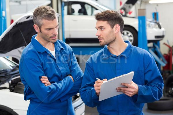 Equipo mecánica hablar junto reparación garaje Foto stock © wavebreak_media