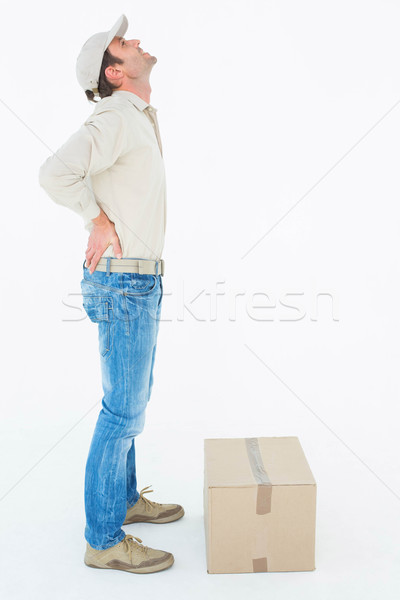 Delivery man suffering from back pain standing by box  Stock photo © wavebreak_media