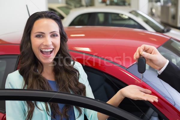 Animado mulher sala de exposição carro Foto stock © wavebreak_media