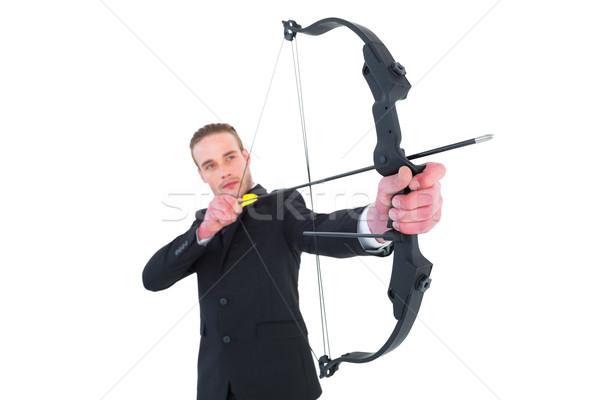 Geconcentreerde zakenman schieten boeg pijl witte Stockfoto © wavebreak_media