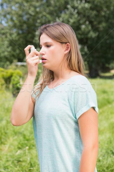 Csinos szőke nő asztma napos idő nő fű Stock fotó © wavebreak_media
