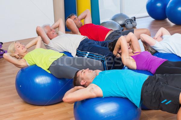 People stretching on exercise balls Stock photo © wavebreak_media