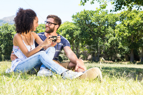 Hipster couple relaxing in the park Stock photo © wavebreak_media