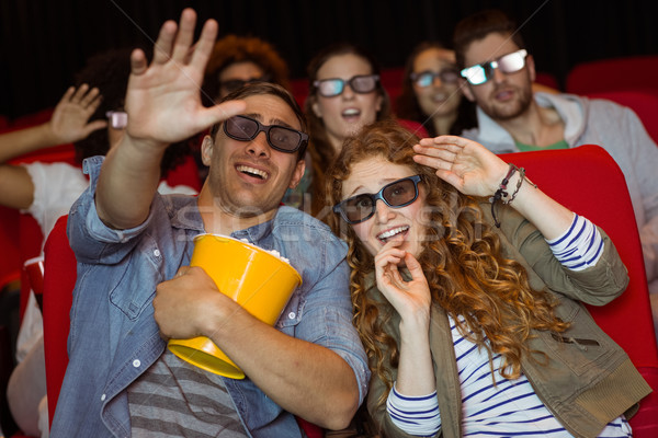 Young friends watching a 3d film Stock photo © wavebreak_media