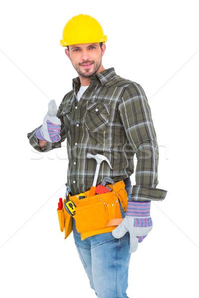 Confident manual worker gesturing thumb up Stock photo © wavebreak_media