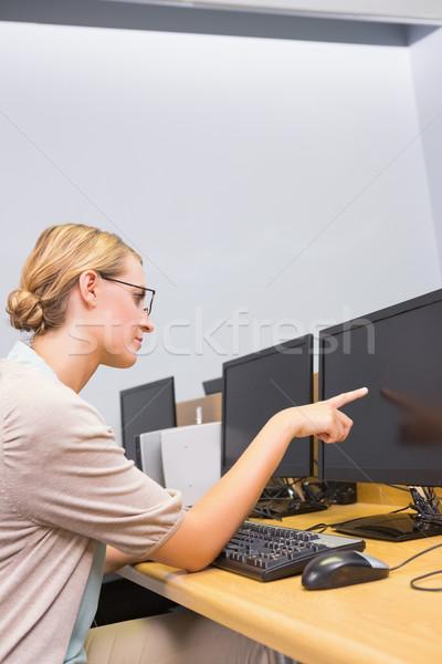 Student working on computer in classroom Stock photo © wavebreak_media